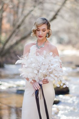 Bridal bouquet of Lunaria, Feathers and Ornamental Grass Seeds with Chloe + Isabel Art Deco Bouquet Brooch. Find it in our Bridal Boutique. Bouquet by Rachel of Fleur-Di-Re. Image: Tiffany Redmon Photography. Model: Anna Dunbar of Honestly West fashion blog. Gown: Meagan Kelly Designs. Hair + Makeup: Vain and Luxe
